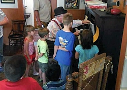Kids loved learning about and operating the player piano on Kid's Day at the museum.