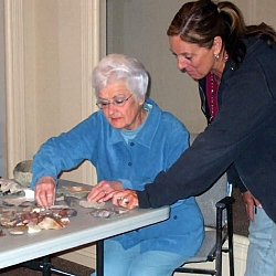 Del works with archeologist Gale Sprague on a display of Kawaiisu artifacts.