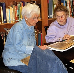 Del and Pat Gracey work on archiving documents in the Research Library.