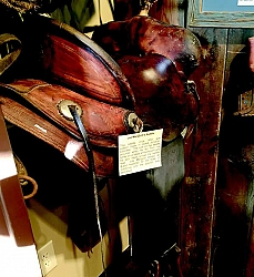 Lee Marigold's Saddle: This saddle, circa 1910, was custom made in Grand Junction, Colorado. The cuts on the saddle occurred when he fell from his horse on a steep embankment and his spur raked across the saddle seat. Lee Marigold served as Brand Inspector for the State of California until the position was abolished.