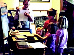 A family looks for Scavenger Hunt items in the Museum.
