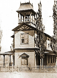 The original Summit School was a two story wooden building with a bell tower. After having been moved across the tracks, the bell tower was removed and the old school became a hotel
