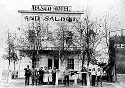 This photo shows the staff of the Basco Hotel on H Street across the tracks from the Southern Pacifc Depot. To the right is the handball court. The hotel was originally the Iriart Hotel.