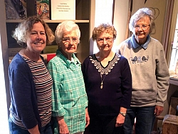Nancy Guidry, Del Troy, Laura Weltin, and Jean Moore work most Tuesday afternoons in the Research Library at the Museum.