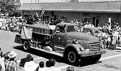 Fire Engines have always been a part of local parades along F Street. This engine is from the California Department of Civil Defense. The building shown is at F and Green Streets. It was moved and is now the home of Fiddler's Crossing on Robinson and F Streets.