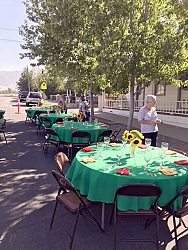 Donna Dieterle, THL Volunteer, helps coordinate the setting of the tables, featuring Basque colors for the linens and bunches of Sunflowers, a traditional Basque symbol.