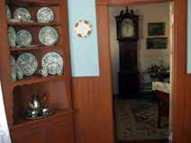 Looking from the newly painted dining room into the parlor, showing the corner cupboard donated by Virginia Sheridan and Bill Lee.