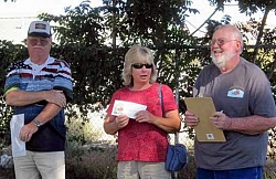 Ken Mazie, Treasurer, on the left and on the right, Geoff Pugh, Co-chairman of the Thunder on the Mountain Car Show and Tehachapi Car Club President present a check to Barbara Williams, Tehachapi Heritage League Board Member and Errea Garden Chairperson.