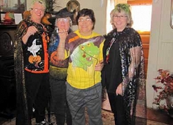Mindi Pugh, Judy Baumgart, Anna Degraff and Barbara Williams greeted guests on Halloween weekend at the Errea House.