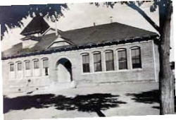 Photo of the brick Tehachapi Elementary School, later renamed Wells School showing arched entrance.