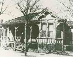 Photo of the wooden house at the corner of D & Curry Streets, which served as the high school until the Snyder Street School was built.