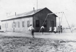 The Monolith School and swings in 1925.