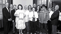 The proud group accepting the Governor's Historic Preservation Award: left to right, Wayne Donaldson, Phil Wyman, Charles White, Janice Williams, Margie Albitre, Brandi Kendrick, June Walker Price, Bob Robinson, Julie Turner, Luther Girado, Ruth Coleman, and Alan Garfinkel.